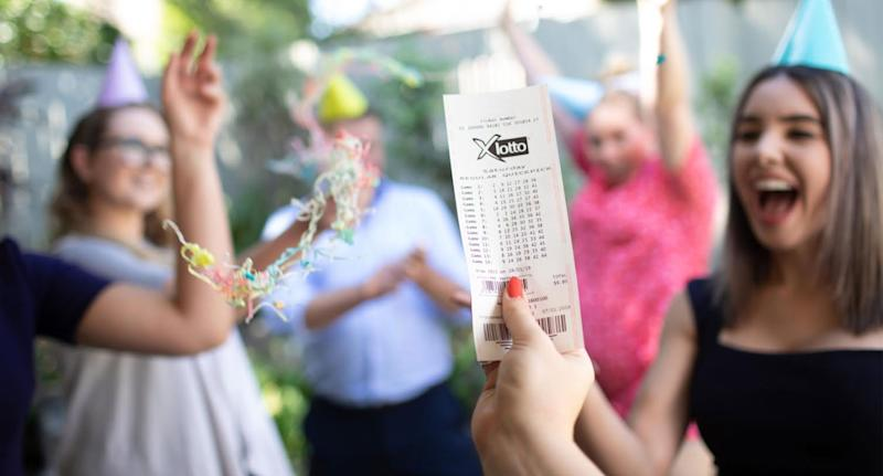 Photo of X Lotto ticket as two friends win $1.6 million each after they both bought tickets with the same numbers.