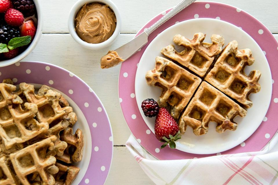 """Elvis famously loved peanut butter and banana sandwiches, often with bacon. It was that delicious combo that led to these family-friendly waffles. I think the King would approve! <a href=""""https://www.epicurious.com/recipes/food/views/elvis-peanut-butter-banana-waffles?mbid=synd_yahoo_rss"""" rel=""""nofollow noopener"""" target=""""_blank"""" data-ylk=""""slk:See recipe."""" class=""""link rapid-noclick-resp"""">See recipe.</a>"""