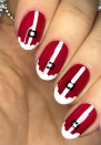 "<p>If Santa Claus is your favorite person around the holidays check out <a href=""https://www.instagram.com/p/B6n4bpsglwo/"" rel=""nofollow noopener"" target=""_blank"" data-ylk=""slk:nail artist Megan's tutorial"" class=""link rapid-noclick-resp"">nail artist Megan's tutorial</a> to recreate this exact look on your own nails. Don't have a steady hand? There are nail wraps that can help you out.</p><p><a class=""link rapid-noclick-resp"" href=""https://www.amazon.com/Christmas-Stickers-Sheets-Full-Cover-Adhesive/dp/B08FRDWSX3?tag=syn-yahoo-20&ascsubtag=%5Bartid%7C10072.g.34113691%5Bsrc%7Cyahoo-us"" rel=""nofollow noopener"" target=""_blank"" data-ylk=""slk:SHOP NAIL WRAPS"">SHOP NAIL WRAPS</a></p>"