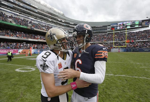New Orleans Saints quarterback Drew Brees (9) and Chicago Bears quarterback Jay Cutler (6) talk after an NFL football game, Sunday, Oct. 6, 2013, in Chicago. Saints won 26-18. (AP Photo/Charles Rex Arbogast)