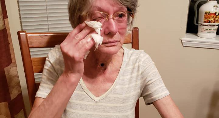 Elaine Arbeau, 67, is pictured wiping tears from her eye.