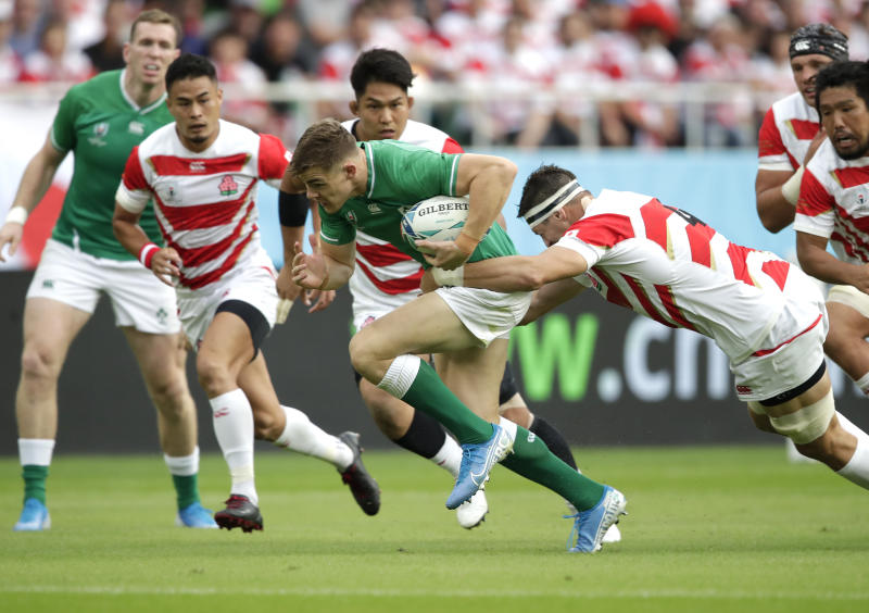 Ireland's Garry Ringrose is tackled by Japan's Luke Thompson during the Rugby World Cup Pool A game at Shizuoka Stadium Ecopa between Japan and Ireland in Shizuoka, Japan, Saturday, Sept. 28, 2019. (AP Photo/Jae Hong)