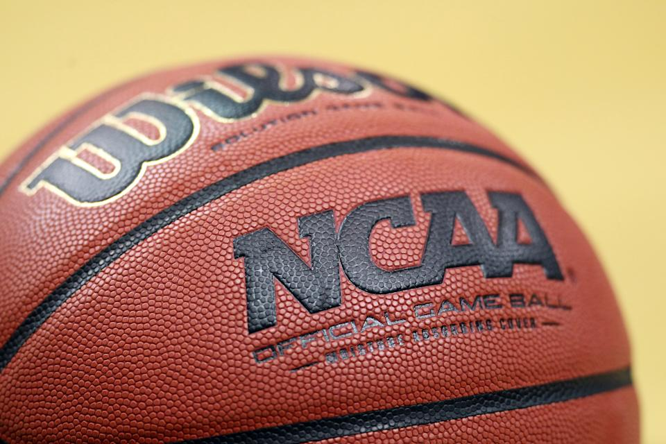 A detail of an official NCAA Men's Basketball game ball made by Wilson is seen on the court as the Iowa State Cyclones play against the Connecticut Huskies during the second round of the 2012 NCAA Men's Basketball Tournament at KFC YUM! Center on March 15, 2012 in Louisville, Kentucky.  (Photo by Andy Lyons/Getty Images)