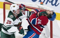 Montreal Canadiens' Phillip Danault is taken out from in front of the Wild's net by Minnesota Wild defenseman Ryan Suter during second-period NHL hockey game action in Montreal, Thursday, Oct. 17, 2019. (Paul Chiasson/The Canadian Press via AP)