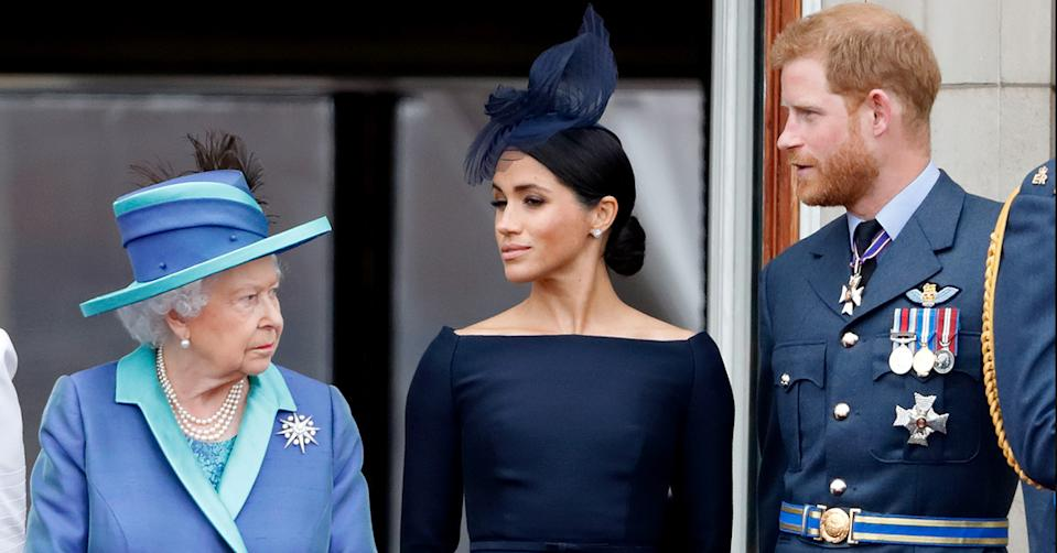 The Queen stands with Meghan Markle and Prince Harry