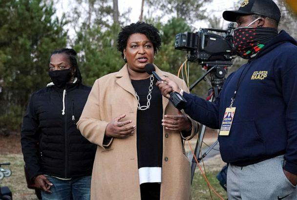 PHOTO: Stacey Abrams speaks to the media about the U.S. Senate runoff elections outside St. Paul's Episcopal Church in Atlanta, Jan. 5, 2021. (Elijah Nouvelage/Reuters)