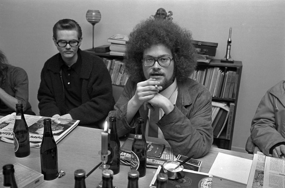 """FILE - In this undated file photo, Chief editor Jacob Ludvigsen talks at an editorial meeting of the small counterculture newspaper that needed an outrageous story for its front page, leading to an 'invasion' of an abandoned 18-century navy base. Copenhagen's Christiania neighborhood is turning 50 and after years of not always peaceful coexistence with the authorities, the counter-culture enclave wants to maintain its reputation as a """"free-wheeling society"""" of hash dealers, political idealists, and aging hippies. One resident says the oasis has"""" become more and more an established part"""" of the Danish capital. It all started in 1971, when a small counterculture newspaper needed an outrageous story for its front page and staged an """"invasion"""" of an abandoned 18-century navy base. (Jacob Maarbjerg//Ritzau Scanpix via AP, File)"""