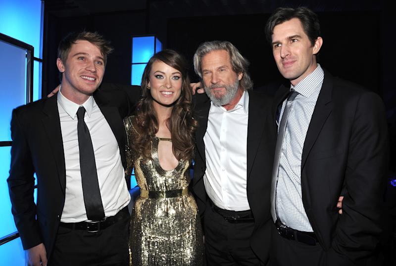 "LOS ANGELES, CA - DECEMBER 11: (L-R) Garrett Hedlund, Olivia Wilde, Jeff Bridges and Director Joseph Kosinski attend Walt Disney's ""TRON: Legacy"" after party on December 11, 2010 in Los Angeles, California. (Photo by John Sciulli/Getty Images)"