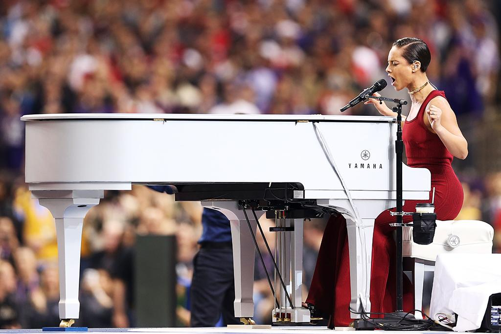 Alicia Keys performs the National Anthem during Super Bowl XLVII between the Baltimore Ravens and the San Francisco 49ers at the Mercedes-Benz Superdome on February 3, 2013 in New Orleans, Louisiana.  (Photo by Christian Petersen/Getty Images)