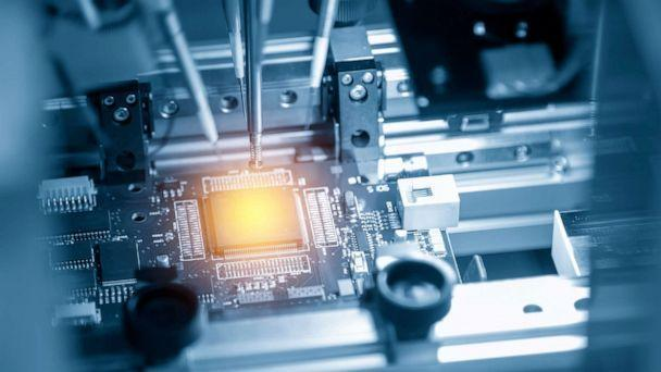 PHOTO: A microchip is illuminated on the main board in the assembly line in an undated stock image. (STOCK PHOTO/Pixel B/Shutterstock )