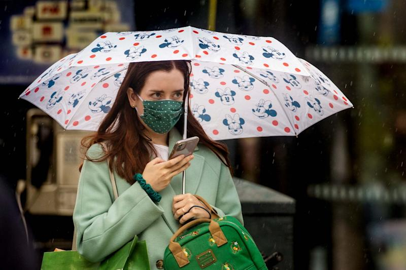 File photo dated 14/07/20 of a woman wearing a face mask. Face coverings will be mandatory in shops and supermarkets from Friday. PA Photo. Issue date: Thursday July 23, 2020: PA