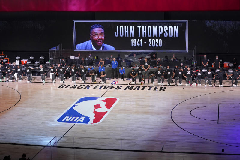 The Miami Heat and the Milwaukee Bucks honored John Thompson before their playoff game on Monday night. (AP Photo/Mark J. Terrill)