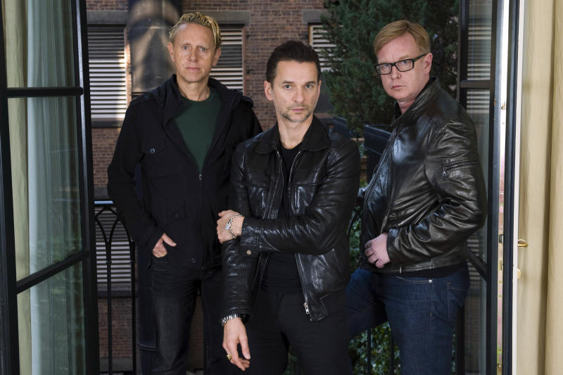 FILE - This Feb. 11, 2009 file photo shows Depeche Mode members Martin Gore, left, Dave Gahan and Andrew Fletcher, right, in New York. The band will be inducted into the  Rock and Roll Hall of Fame, joined by the Doobie Brothers, Nine Inch Nails and T-Rex. (AP Photo/Charles Sykes, File)