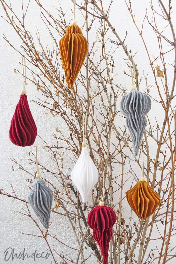 """<p>Mimic the look of vintage ornaments with a little bit of jewel-toned craft felt and some glue. </p><p><em>Get the tutorial at <a href=""""https://www.ohohdeco.com/felt-christmas-ornaments-patterns/"""" rel=""""nofollow noopener"""" target=""""_blank"""" data-ylk=""""slk:Oh Oh Deco"""" class=""""link rapid-noclick-resp"""">Oh Oh Deco</a>.</em></p><p><a class=""""link rapid-noclick-resp"""" href=""""https://www.amazon.com/Polyester-Sheet-Flexible-Sheets-Maroon/dp/B07S23ZX6T?tag=syn-yahoo-20&ascsubtag=%5Bartid%7C10072.g.34443405%5Bsrc%7Cyahoo-us"""" rel=""""nofollow noopener"""" target=""""_blank"""" data-ylk=""""slk:SHOP FELT"""">SHOP FELT</a></p>"""