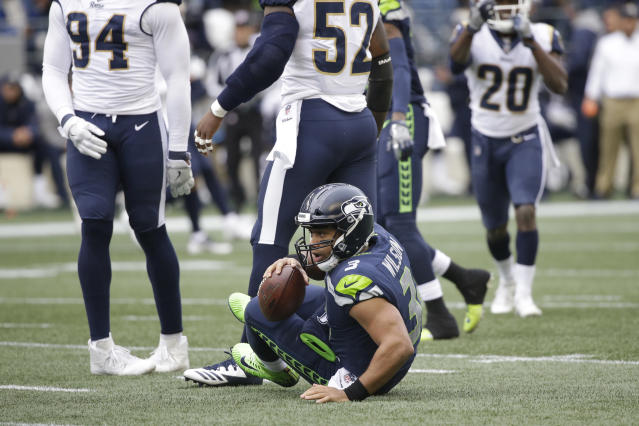 The Seattle Seahawks' Russell Wilson was sacked seven times on Sunday. (AP)