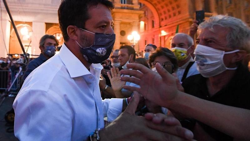 Italians defy coronavirus to vote in local elections and change the constitution