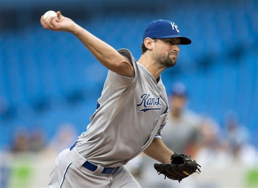 Kansas City Royals starting pitcher Luke Hochevar pitches to the Toronto Blue Jays during the first inning of a baseball game in Toronto on Thursday, July 5, 2012. (AP Photo/The Canadian Press, Frank Gunn)