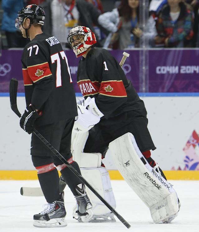 =Canada forward Jeff Carter, left, and Canada goaltender Roberto Luongo skate off the ice together after beating Austria 6-0 in a men's ice hockey game at the 2014 Winter Olympics, Friday, Feb. 14, 2014, in Sochi, Russia. Carter scored a hat trick in the game and Luongo recorded a shutout. (AP Photo/Mark Humphrey)