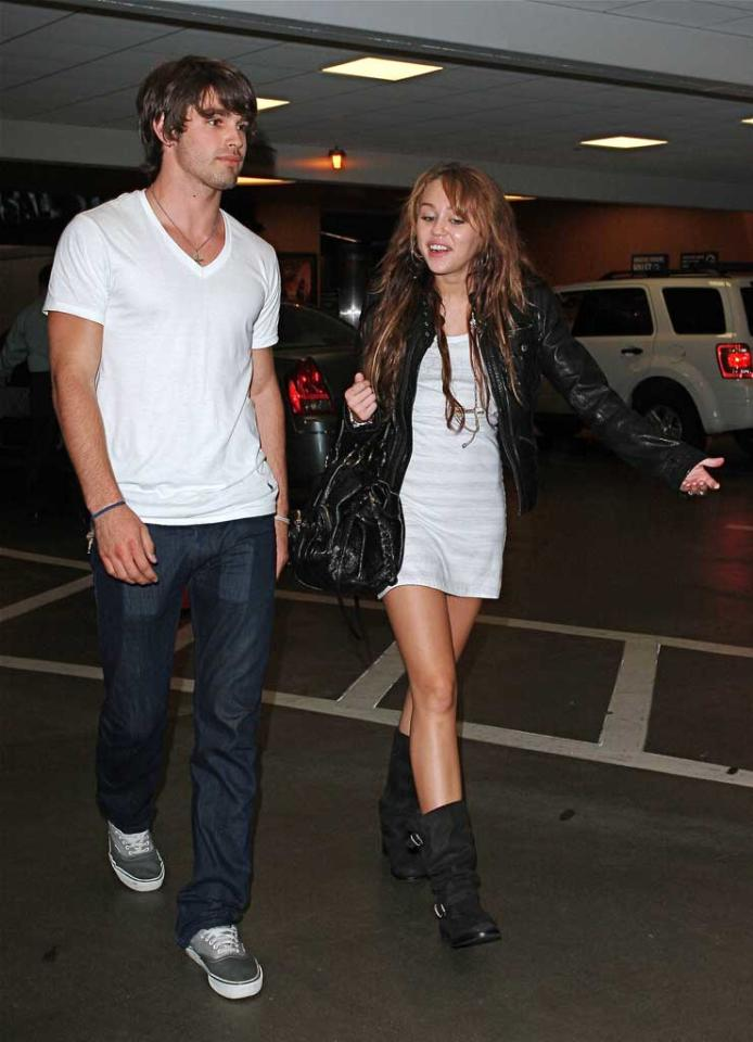 """Miley Cyrus was spotted with underwear model Justin Gaston not once, not twice, but three times last week. Are they more than friends? Surely Miley's parents know better than to allow their underage daughter to date a 20-year-old, especially after her Vanity Fair photo scandal! <a href=""""http://www.x17online.com"""" target=""""new"""">X17 Online</a> - September 16, 2008"""