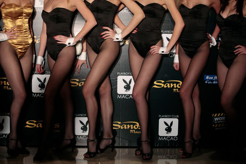Models pose for a picture during a promotional event for the upcoming opening of the Playboy club in Macau