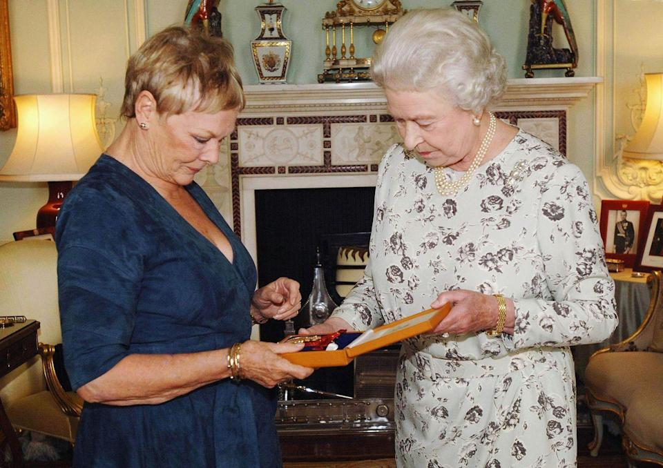 <p>Though she played a <em>different</em> Queen Elizabeth in <em>Shakespeare in Love</em>, Dame Judi Dench kind of copied the Queen's hairstyle when she met the current monarch. Life imitating art?</p>