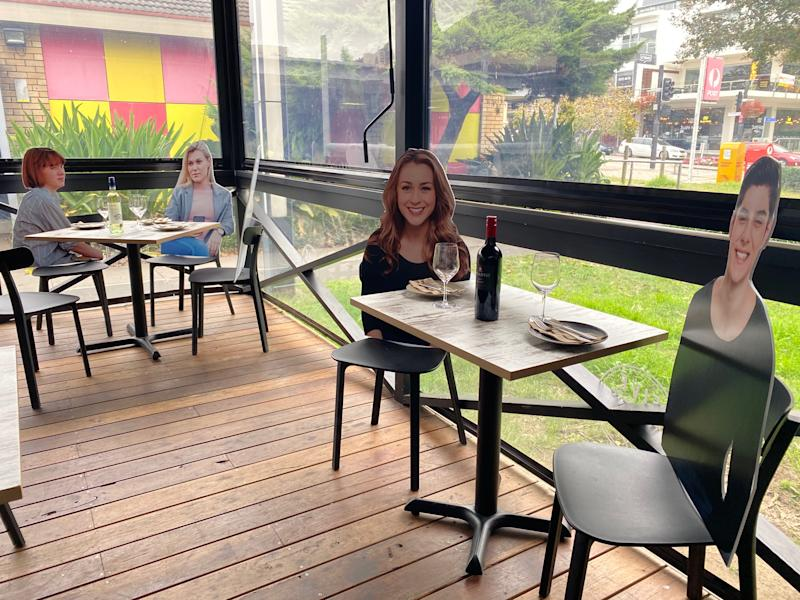 Cardboard cutout figures at Five Dock Dining in Five Dock, Australia. | Photo courtesy of Frank Angilletta/Five Dock Dining