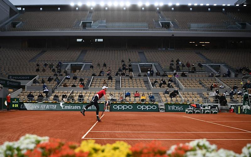 Andy Murray serves during his clash with Stan Wawrinka - Getty Images