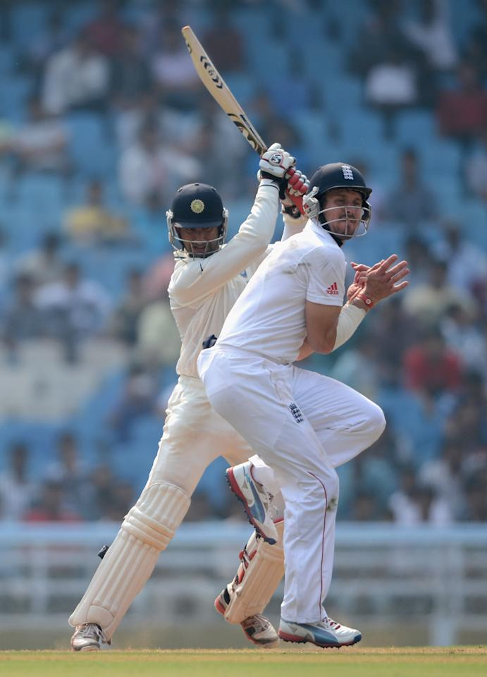 MUMBAI, INDIA - NOVEMBER 04:  Cheteshwar Pujara of Mumbai A hits past Nick Compton of England during day two of the tour match between Mumbai A and England at The Dr D.Y. Palit Sports Stadium on November 4, 2012 in Mumbai, India.  (Photo by Gareth Copley/Getty Images)
