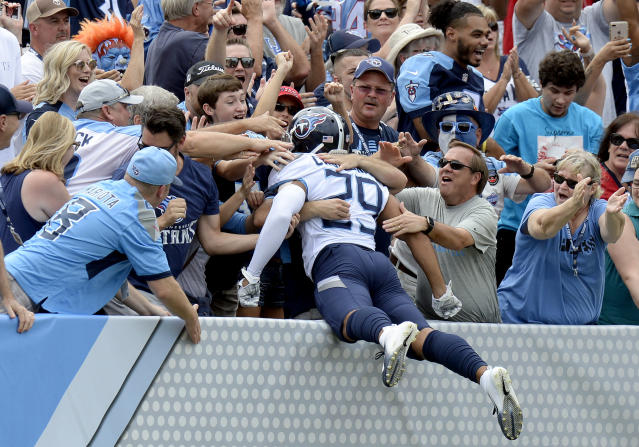 <p>Fans celebrate with Tennessee Titans' Dane Cruikshank (29) after he scored a touchdown on a fake punt against the Houston Texans in the first half of an NFL football game Sunday, Sept. 16, 2018, in Nashville, Tenn. (AP Photo/Mark Zaleski) </p>