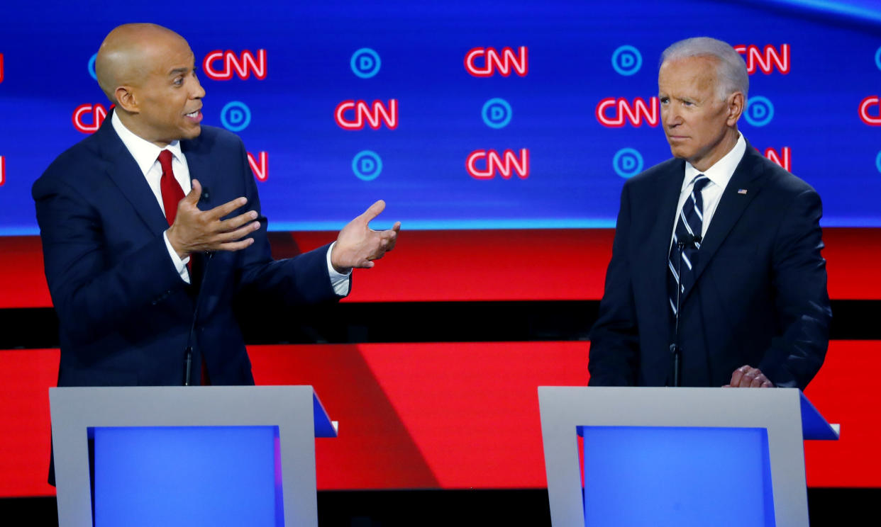 In this July 31, 2019 file photo, Sen. Cory Booker, D-N.J., gestures to former Vice President Joe Biden during the second of two Democratic presidential primary debates hosted by CNN in the Fox Theatre in Detroit.   (AP Photo/Paul Sancya)