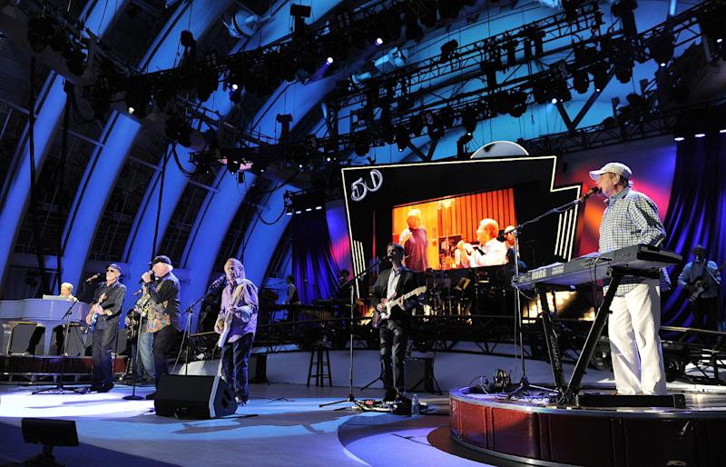 FILE - In this June 2, 2012 file photo, The Beach Boys perform at the Hollywood Bowl in Los Angeles. Brian Wilson says he felt blindsided by a news release from his Beach Boys bandmate Mike Love that ended the good vibrations on the band's 50th anniversary tour. Wilson says the expectation was that both sides would help craft and approve the news release. That didn't happen and now he thinks it's Love's turn to reach out. (Photo by Chris Pizzello/Invision/AP, File)