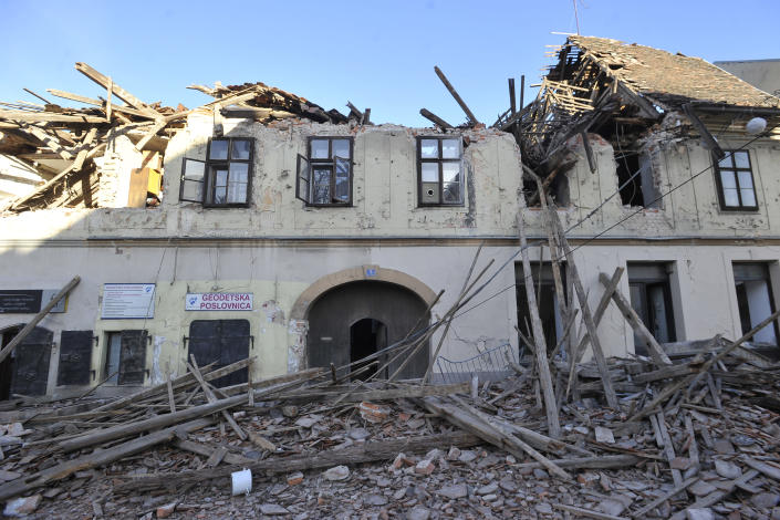 A view of a building damaged in an earthquake, in Petrinja, Croatia, Tuesday, Dec. 29, 2020. A strong earthquake has hit central Croatia and caused major damage and at least one death in a town southeast of the capital. (AP Photo)