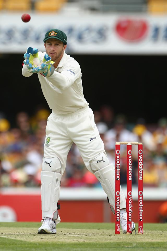 BRISBANE, AUSTRALIA - NOVEMBER 11:  Matthew Wade of Australia catches a return throw during day three of the First Test match between Australia and South Africa at The Gabba on November 11, 2012 in Brisbane, Australia.  (Photo by Mark Kolbe/Getty Images)