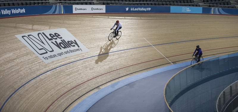 LONDON, ENGLAND - MARCH 12: Cyclists ride in the Velodrome at the Lee Valley Velopark, formerly the cycling venue for the London 2012 Olympic Games, on March 12, 2014 in London, England. The Lee Valley Velopark opens to the general public on March 31, 2014 and offers all four Olympic cycling disciplines of track, BMX, road and mountain biking. (Photo by Oli Scarff/Getty Images)