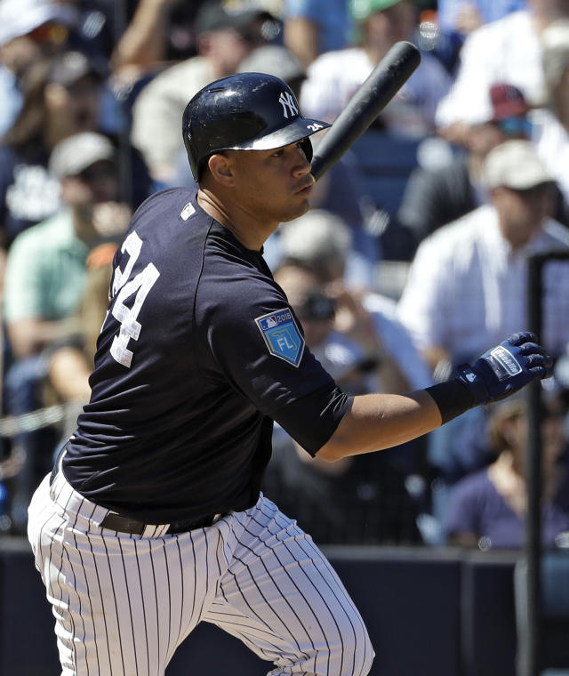 New York Yankees' Gary Sanchez watches his two-run double off Pittsburgh Pirates pitcher Sean Keselica during the fourth inning of a spring training baseball game Thursday, March 15, 2018, in Tampa, Fla. (AP Photo/Chris O'Meara)