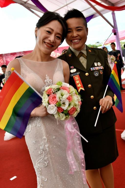 Yi Wang (R) and Yumi Meng were among the first same-sex couples to get married in a mass wedding held by the Taiwanese military