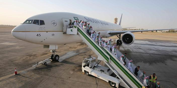 Passengers disembarking from a plane belonging to the airline Saudia in 2017.