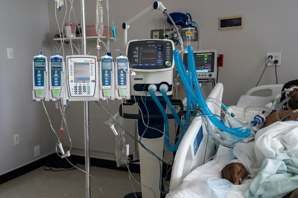 A patient is connected to a ventilator and other medical devices in the COVID-19 intensive care unit at the United Memorial Medical Center on July 2, 2020 in Houston, Texas.