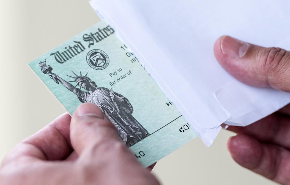 Men hands holding a US Government Treasury check