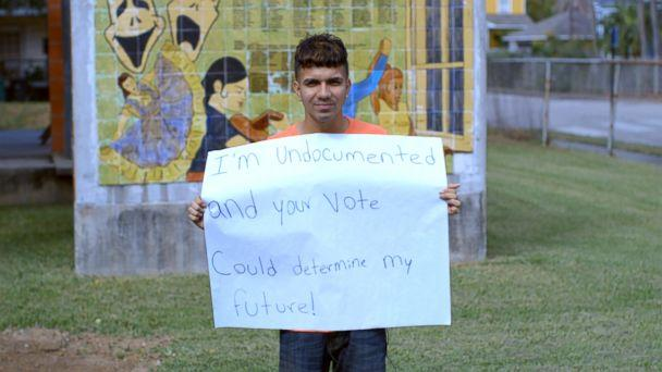 PHOTO: Undocumented student Dennis Rivera holds a sign in Houston, TX. (ABC News)