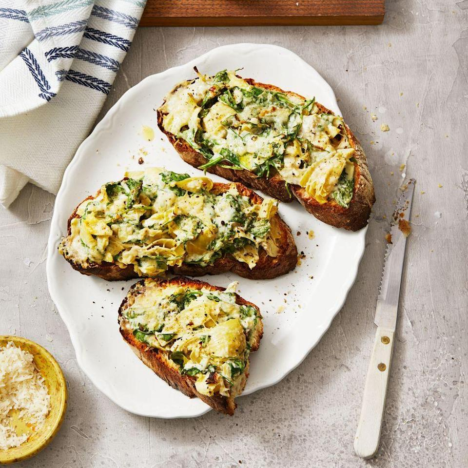 "<p>Your favorite party appetizer becomes an easy weeknight meal when piled on top of toast and broiled.</p><p><em><a href=""https://www.goodhousekeeping.com/food-recipes/a35037145/spinach-artichoke-tartines-recipe/"" rel=""nofollow noopener"" target=""_blank"" data-ylk=""slk:Get the recipe for Spinach Artichoke Tartines »"" class=""link rapid-noclick-resp"">Get the recipe for Spinach Artichoke Tartines »</a></em></p>"
