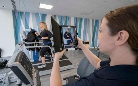 Physiotherapist Emily Drakes monitors Danielle Robinson's running style and foot strikes - Credit: JULIAN SIMMONDS/ THE TELEGRAPH