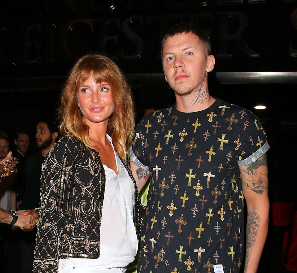 LONDON, UNITED KINGDOM - SEPTEMBER 26: Professor Green and Millie Mackintosh arriving at INK night club on September 26, 2013 in London, England. (Photo by Mark Robert Milan/FilmMagic)