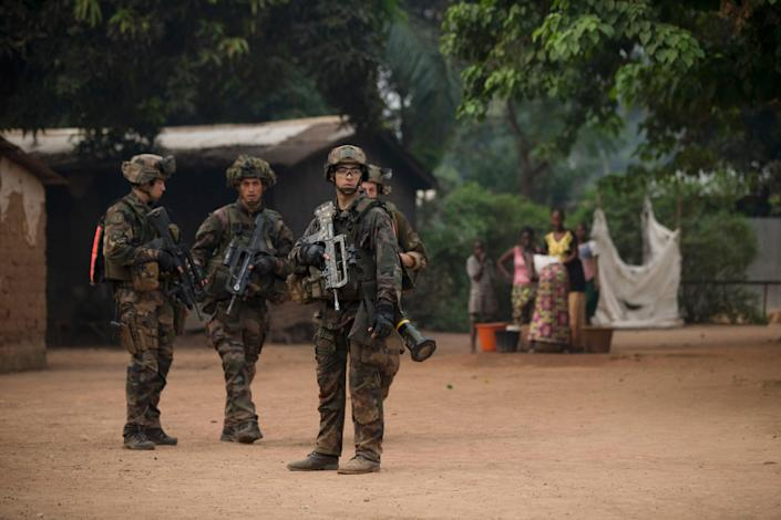 French soldiers secure an area of the Miskine neighborhood of Bangui, Central African Republic, Thursday, Dec. 26, 2013. The spokesman for an African Union peacekeeping force says six Chadian peacekeepers were killed and 15 were wounded, after being attacked Wednesday.(AP Photo/Rebecca Blackwell)