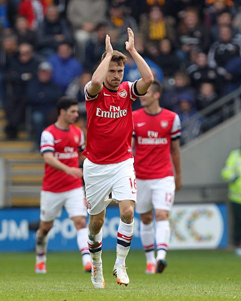 Arsenal's Aaron Ramsey celebrates scoring his side's first goal during their English Premier League soccer match against Hull City at The KC Stadium, Hull, England, Sunday, April 20, 2014. (AP Photo/Lynne Cameron, PA Wire) UNITED KINGDOM OUT - NO SALES - NO ARCHIVES