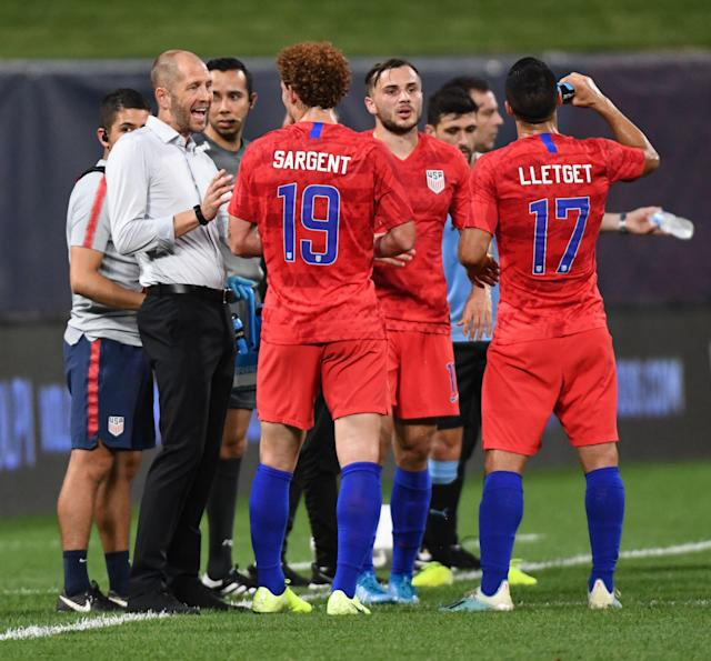 USMNT coach Gregg Berhalter (L) gives instructions to striker Josh Sargent during the international friendly against Uruguay on Tuesday. (Getty)