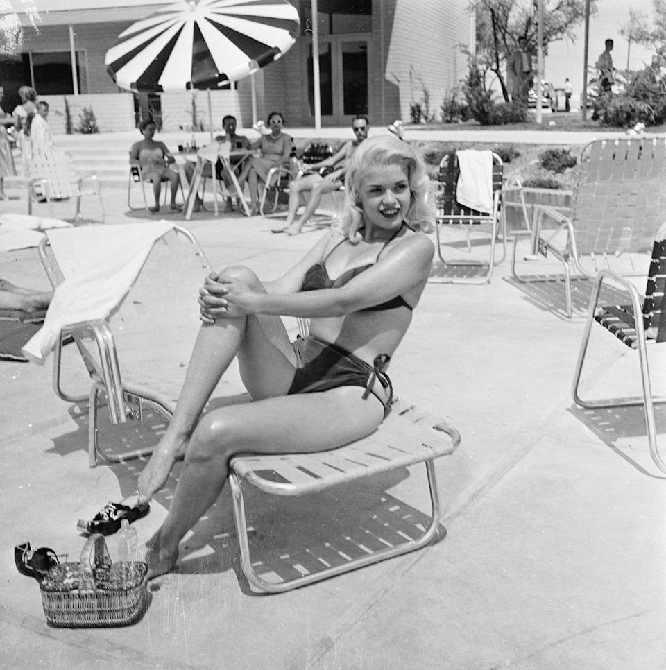 <p>Actress Jayne Mansfield poses by the pool of the Dunes hotel in 1955. She died in a car accident at the age of 34.</p>