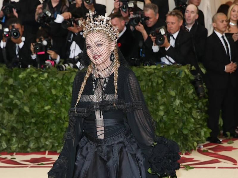 Madonna sued by fans over late New York shows