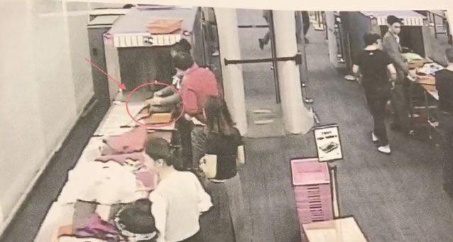A still from airport staff. They showed this to the guard while questioning her. Source: Newsflare
