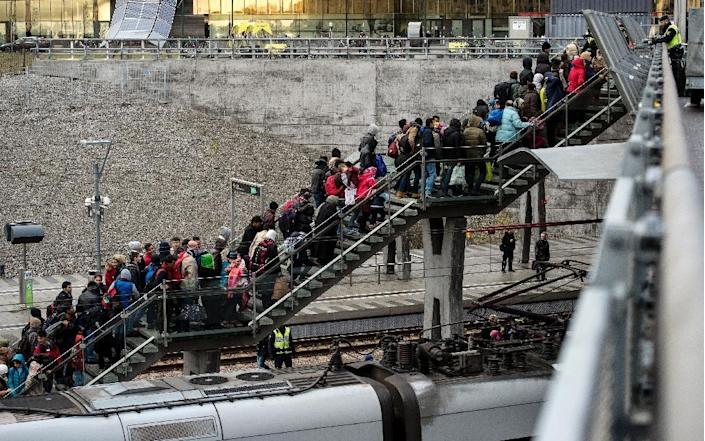 Refugees arriving in Malmo, Sweden wait in line in 2015 as the country has registered 400,000 asylum applications since 2012 (AFP Photo/JOHAN NILSSON)